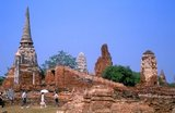 Wat Phra Mahathat was built during the reign of Borommaracha I (Boromma Rachathirat I) or Khun Luang Pa Ngua (1370- 1388), who was the third king of the Ayutthaya Kingdom.<br/><br/>  Ayutthaya (Ayudhya)) was a Siamese kingdom that existed from 1351 to 1767. Ayutthaya was friendly towards foreign traders, including the Chinese, Vietnamese (Annamese), Indians, Japanese and Persians, and later the Portuguese, Spanish, Dutch and French, permitting them to set up villages outside the city walls. In the sixteenth century, it was described by foreign traders as one of the biggest and wealthiest cities in the East. The court of King Narai (1656–1688) had strong links with that of King Louis XIV of France, whose ambassadors compared the city in size and wealth to Paris.